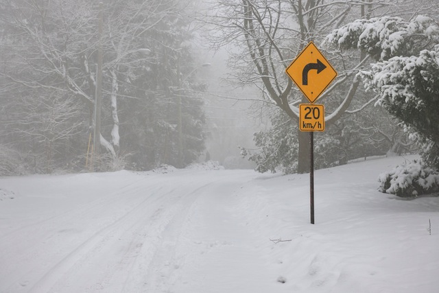 Right turn warning sign on winter road