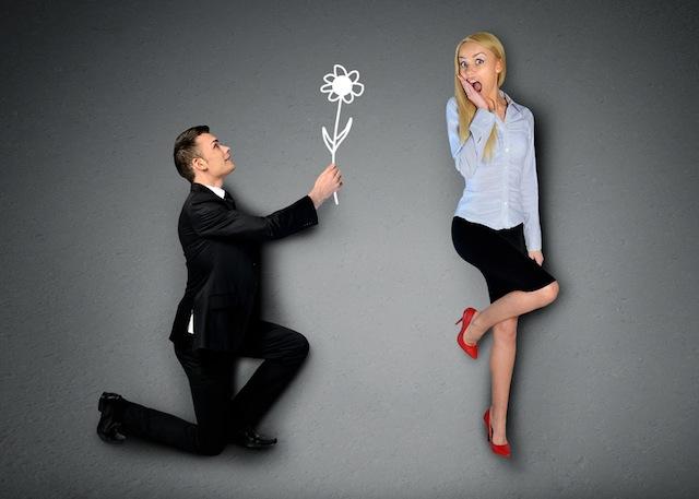 Business man giving flower
