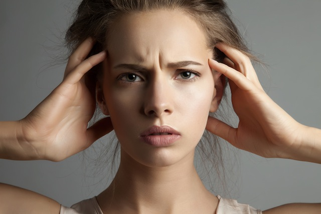 woman in stress watching at camera