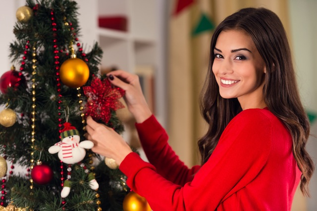 Portrait of a young woman during preparations for Christmas at home